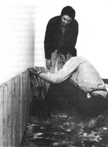 Dale Hickey watches contractor Jim Emmins construct a fence at the Pinacotheca gallery, St Kilda, October 1969.